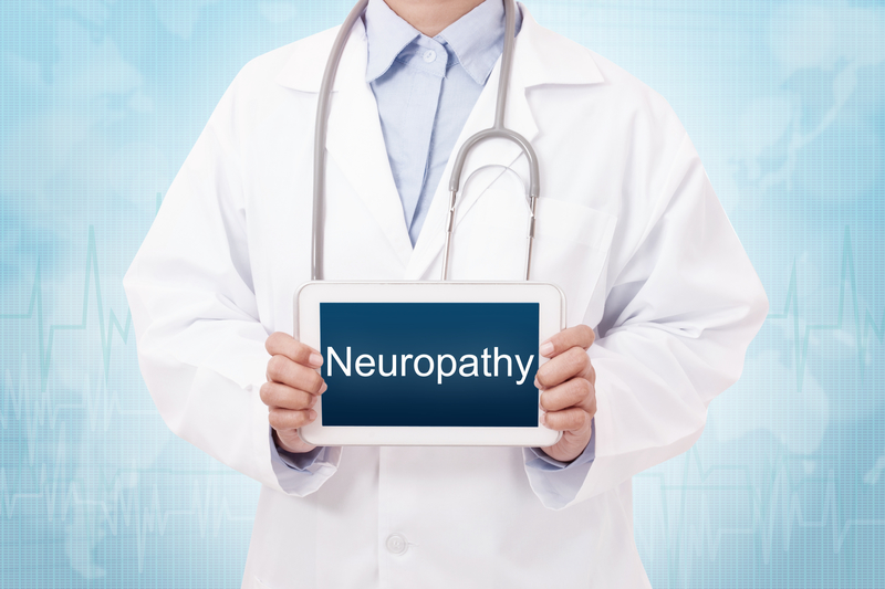 """Doctor holding up a sign that says """"neuropathy"""""""