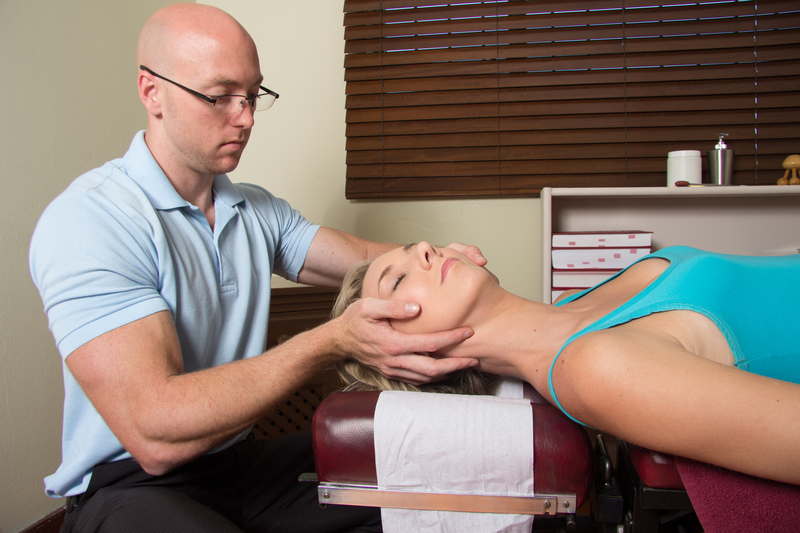 Woman receiving chiropractic care for her neck