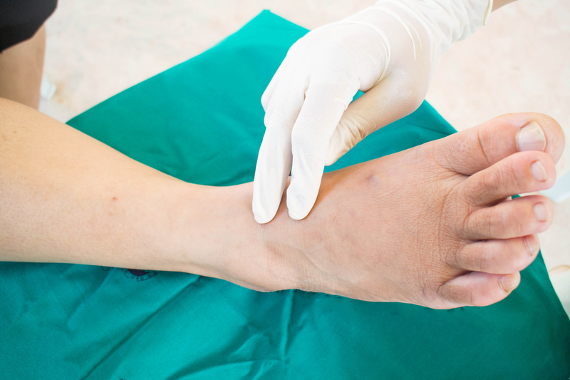patient with neuropathy symptoms in their feet