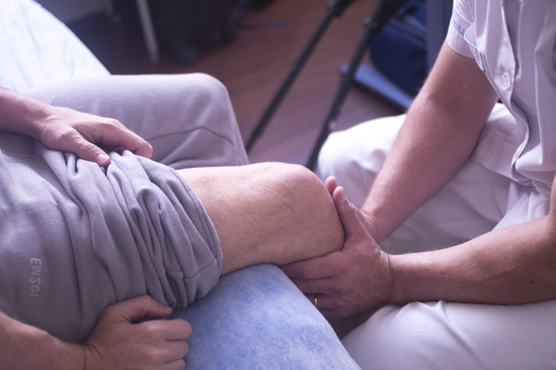 person receiving help for neuropathy symptoms in their legs